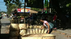 Selling hand made baskets on the road in the Republic of the Philippines Stock Footage