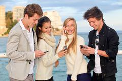 young people phones - stock photo
