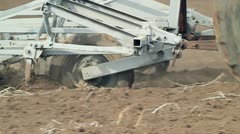 Plows Cultivating Soil. Slow Motion. Stock Footage