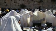 Stock Video Footage of Cohanim raise their hands during Priestly Blessing at the Western Wall