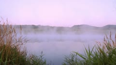 Lilac fog at lake Stock Footage