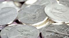 Spinning silver coins Stock Footage