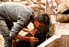 INDIA Kumbh Mela 2013 Varanasi man washing Stock Photos