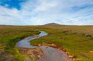 Stock Photo of summer iceland landscape with river and bright blue sky