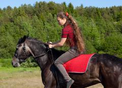 Girl rides a horse Stock Photos