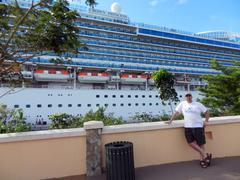 Man stands by Cruise Ship at port Stock Photos