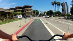 Riding Bicycle In Designated Bike Lane- Long Beach CA Stock Footage