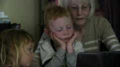 Grandmother, eager  grandson, computer,m Stock Footage