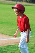 Baseball player walking across field. Stock Photos