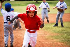 little league baseball player running bases - stock photo
