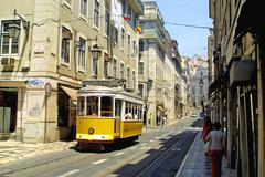 Typical yellow tram on the street in Lisbon - stock photo