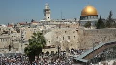 Thousands of Jews attend the Priestly Blessing at the Western Wall Stock Footage