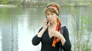 Confused or lost woman on a cell phone Stock Footage