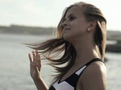Young woman by the sea, super slow motion, shot at 240fps NTSC Stock Footage