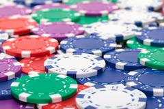background from of multicolored poker chips - stock photo