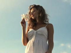 Young woman smelling flowers, super slow motion, shot at 240fps NTSC - stock footage