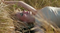 Cute Girl Lying On Grass - stock footage