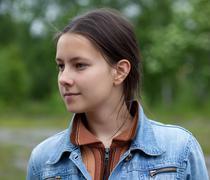A girl in a denim jacket Stock Photos
