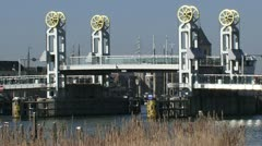 Vertical lift bridge over River IJssel closes Stock Footage