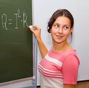 beautiful girl in a physics class - stock photo