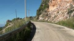 Zoom in along asphalt road Stock Footage