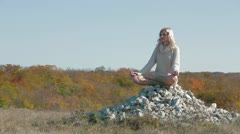 Model In Lotus Pose Stock Footage
