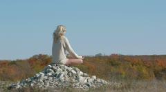 Girl Meditating In Lotus Pose Stock Footage