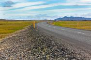 Stock Photo of highway through icelandic landscape under a blue summer sky