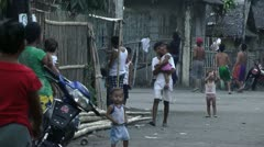 Poor people on the street on freeland next to the ocean in Philippines Stock Footage