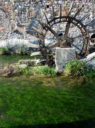 Antique watermill and river Stock Photos