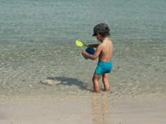 Cute kid playing in the sea, super slow motion, shot at 240fps NTSC Stock Footage