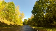 Stock Video Footage of Driving through gold and green trees on a curvy country road in early fall