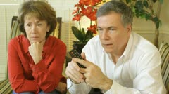 Mature couple looking at something scary on tv Stock Footage