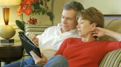 Mature couple looking at something on a tablet pc Stock Footage