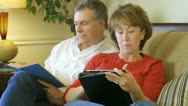 Mature couple relaxing on a couch Stock Footage