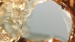 Green tea splashing ultra close-up slow motion product shot - stock footage