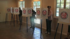 VOTERS IN VOTING BOOTHS Stock Footage