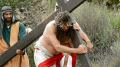 Stock Video Footage of Christ carrying the cross road to Calvary