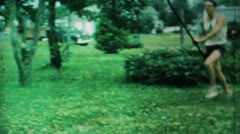 Stock Video Footage of Grandpa Approves Of Grandson Pole Vaulting In Backyard-1962 Vintage 8mm film.