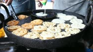Stock Video Footage of Static Shot: Hands making jalebi/funnel cake an Indian cuisine.