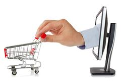 computer monitor and hand with shopping cart - stock photo