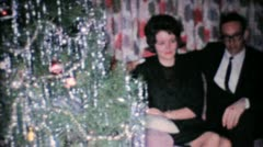 Young Couple Admires Poinsettia Plant At Christmas-1962 Vintage 8mm film Stock Footage