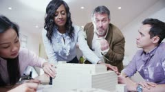 Dynamic young architects in a business meeting Stock Footage