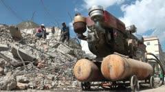 Machinery, demolition, Tibetan town, Xiahe, China Stock Footage