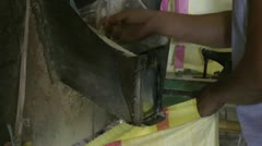 Dehusking rice in a ricemill in the Philippines Stock Footage
