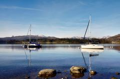 view of lake windermere with two boats - stock photo