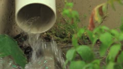 Rainwater Flows From Pipe - stock footage