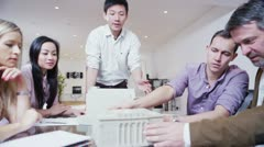 Stock Video Footage of Dynamic young architects in a business meeting