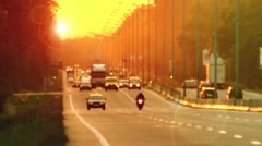 The cars traffic, evening, highway, strong zoom, sunset Stock Footage