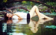 Girl lying on the water - stock photo